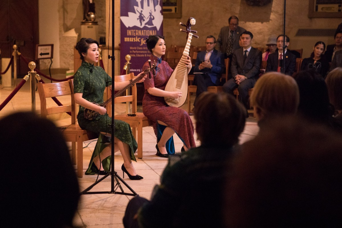 "(From left) Chen Yan and Zhang Jianzhen perform in Musical Bridges Around the World's program ""Gems of China"" at San Fernando Cathedral."