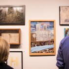 A crowd looks at artwork by 300 local artists in the show Common Currents showcasing San Antonio's history.