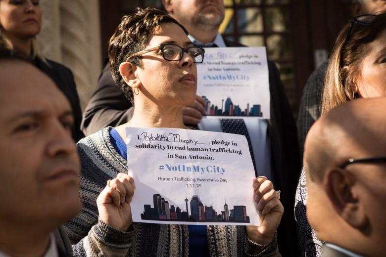 Rebekka Murphy holds a pledge to end human trafficking in San Antonio for Human Trafficking Awareness Day.