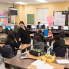 4th grade math and science teacher Jennifer Pantoia works with her students at Stonewall Flanders Elementary