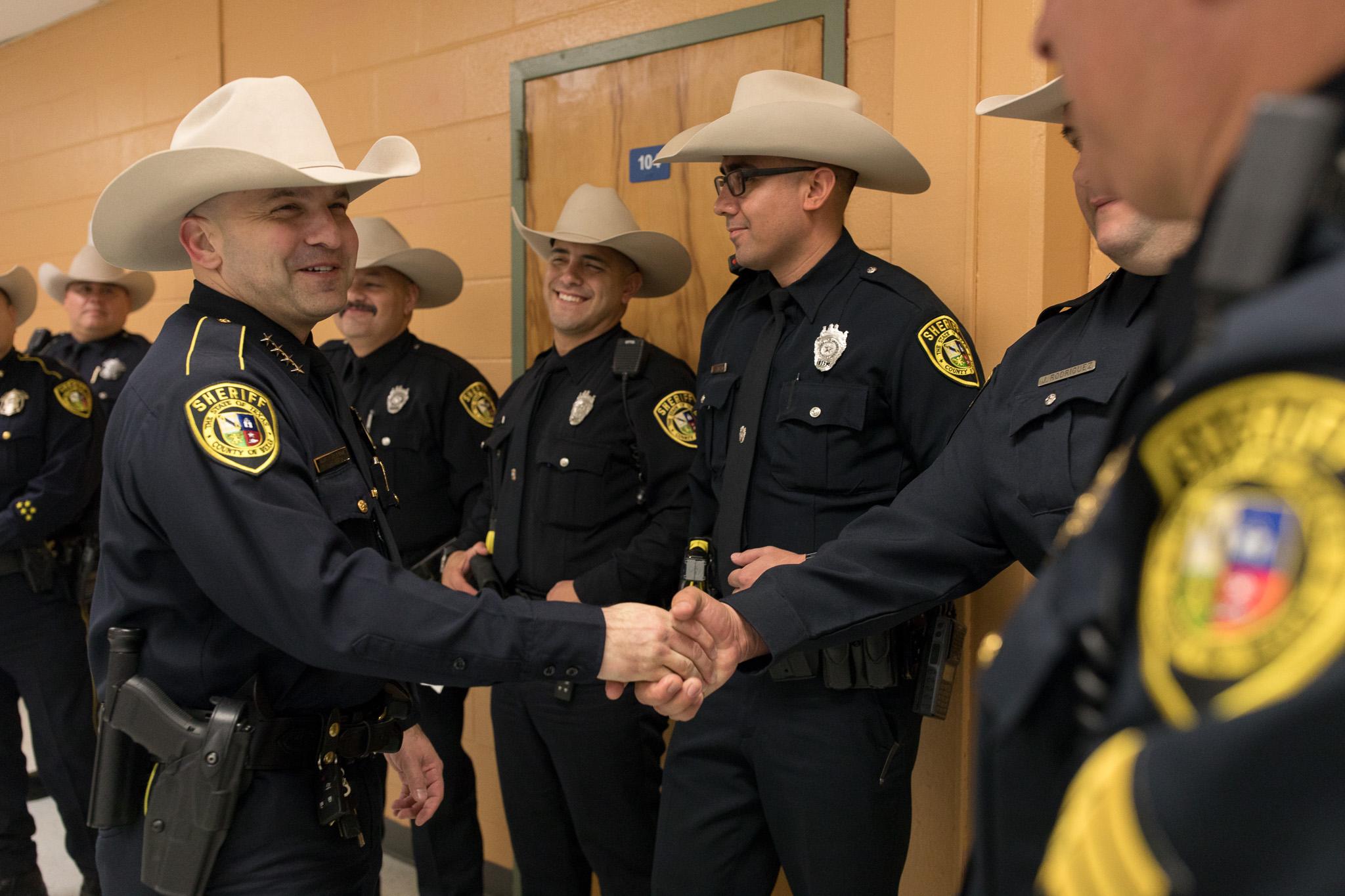 Bexar County Sheriff Javier Salazar shakes the hands of deputies at the Bexar County Sheriff Department Training Academy.