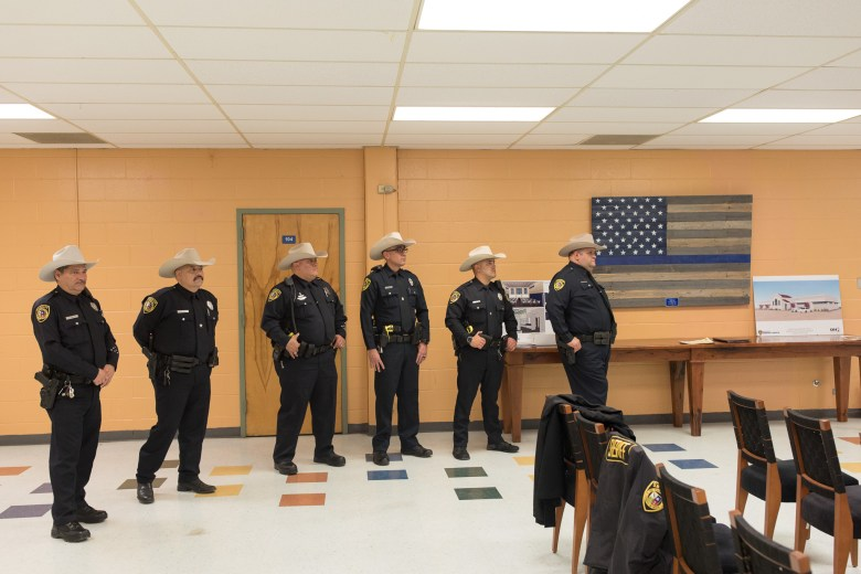 Bexar County Sheriff Deputies that work with community relations stand in the back of the room during the training.