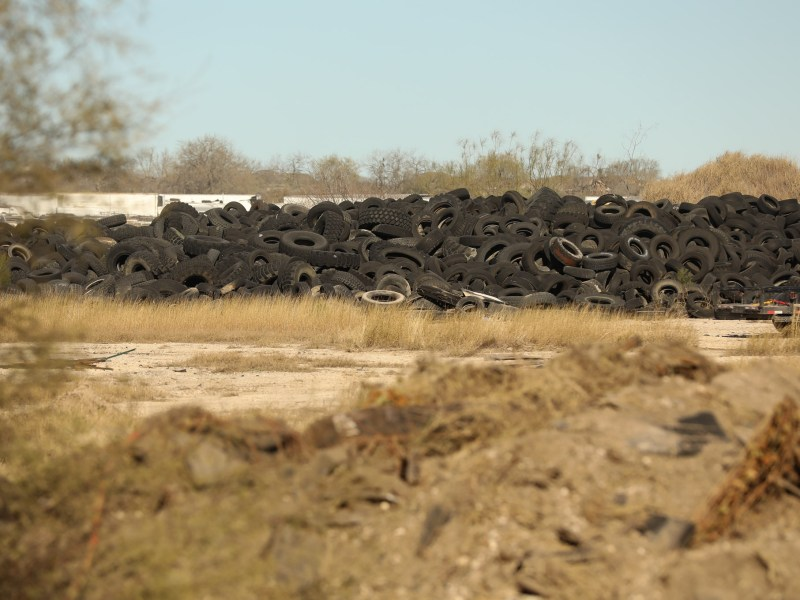 Discarded tires lay in a long strip on the 36 acre property off of Applewhite Road in the city's Southside.