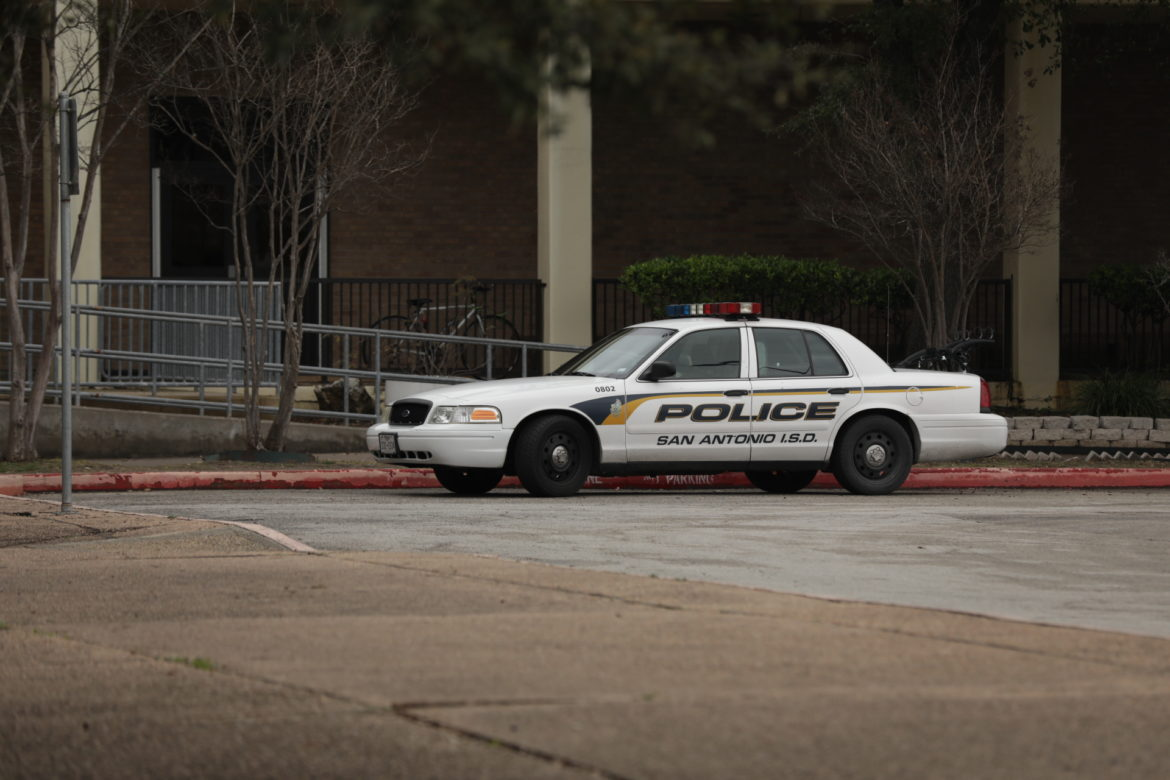 A San Antonio Independent School District police vehicle is parked outside Brackenridge High School.
