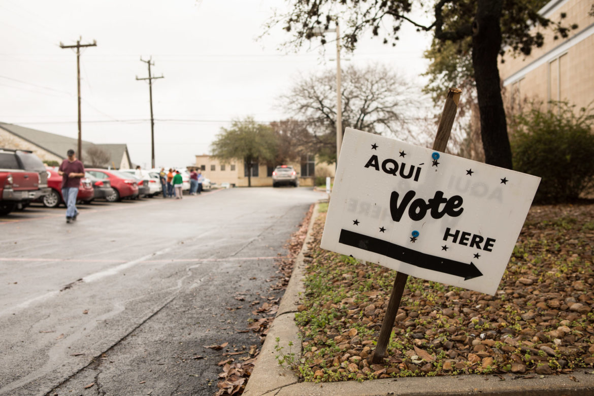A sign indicates where to vote at Brook Hollow Library.