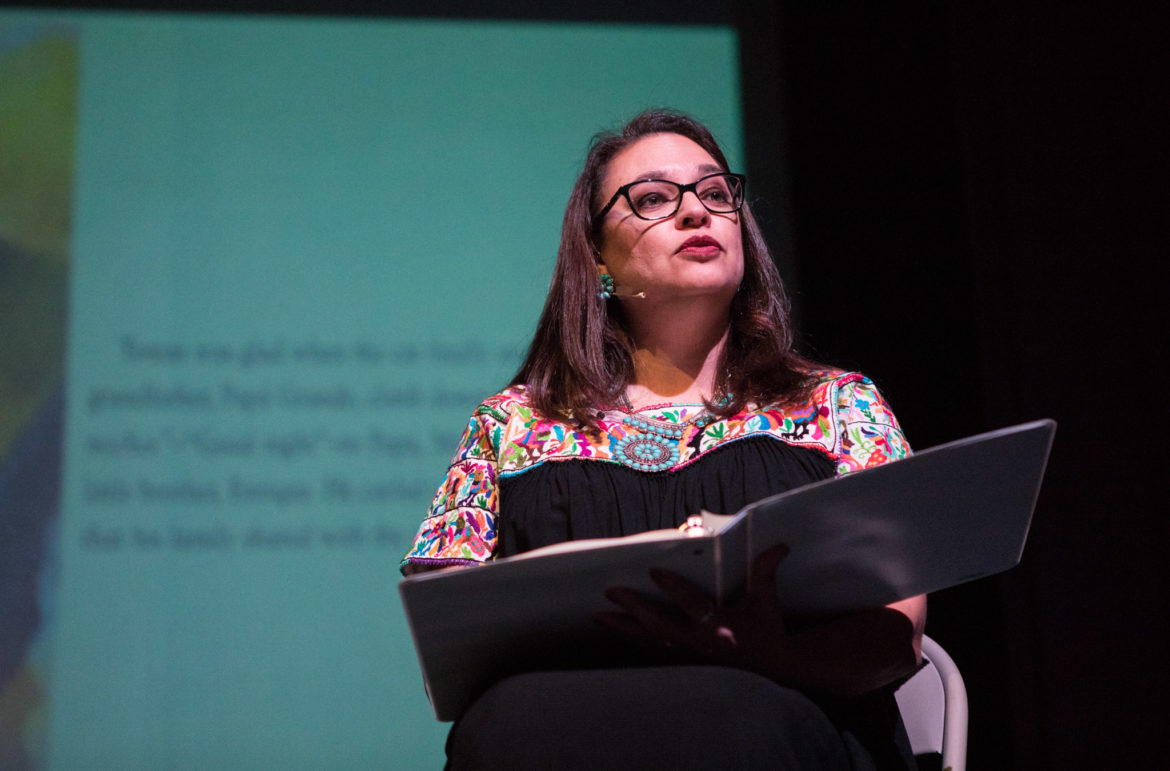 """Author Diana Lopez reads the book """"Tomas and the Library Lady"""" to an audience at Magik Reader's Theatre."""