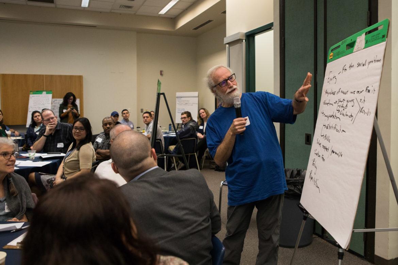 Stuart Birnbaum presents his group's ideas at SA Climate Ready Town Hall at UTSA Downtown.