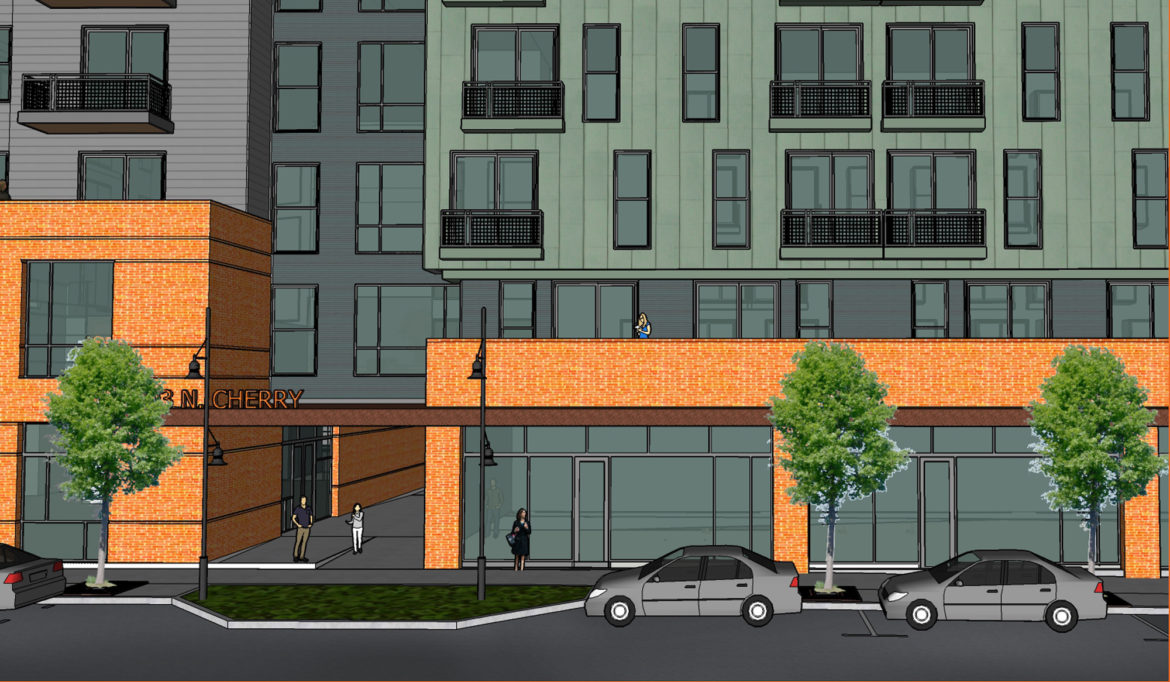 """The re-designed project includes an underground parking lot for tenants and a """"pocket park"""" for the public."""