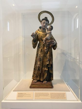 An 18th century statue of Saint Anthony of Padua greets visitors to the San Antonio 1718: Art from Viceregal Mexico exhibition at the San Antonio Museum of Art.