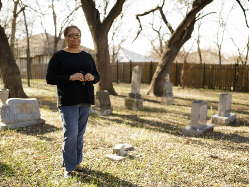"Melanie Brooks stands in the cemetery of her relatives. ""We want to forget"" she says in response to the lack of taught history of the African-American population."