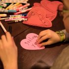 Jacob, 8, makes a valentine to give to others on Valentine's Day.