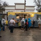 Festival goers line up in front of a food truck at Botánica Music Festival.