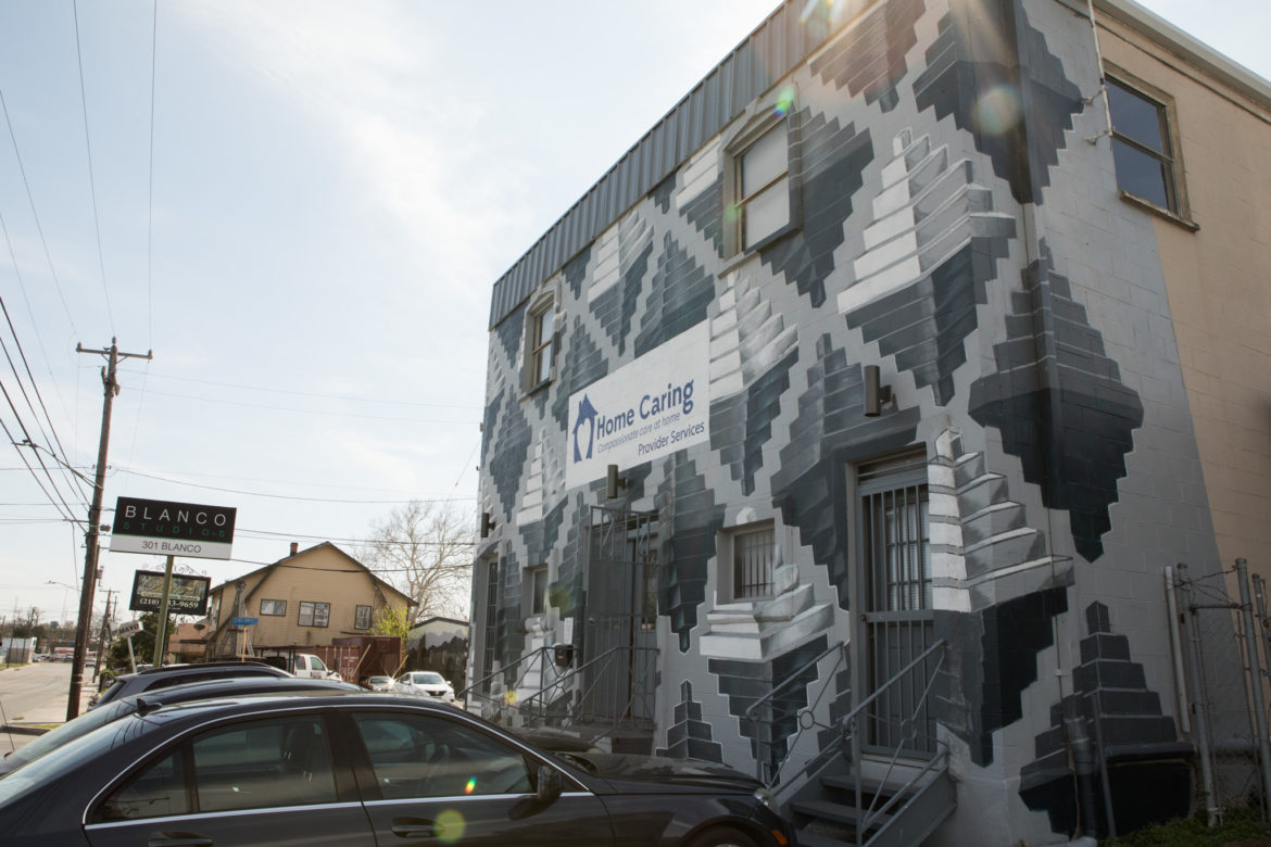 Claudio Aguillon's mural covers the facade of Home Caring on Blanco Road.