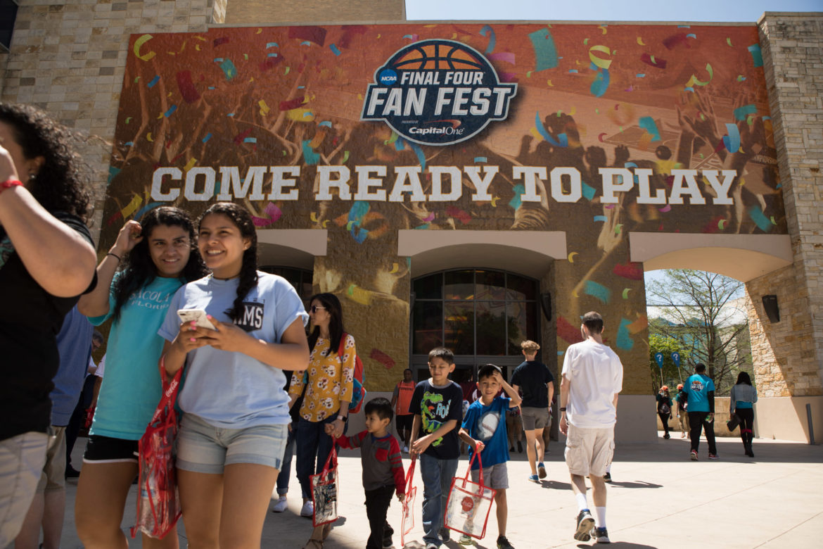 Basketball fans exit the Final Four Fan Fest area in the Henry B. Gonzalez Convention Center.