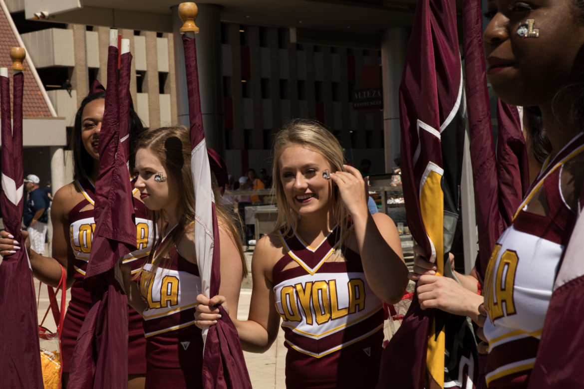 The Loyola University Chicago Cheer Team greets fans in front of the Henry B. Gonzalez Convention Center.