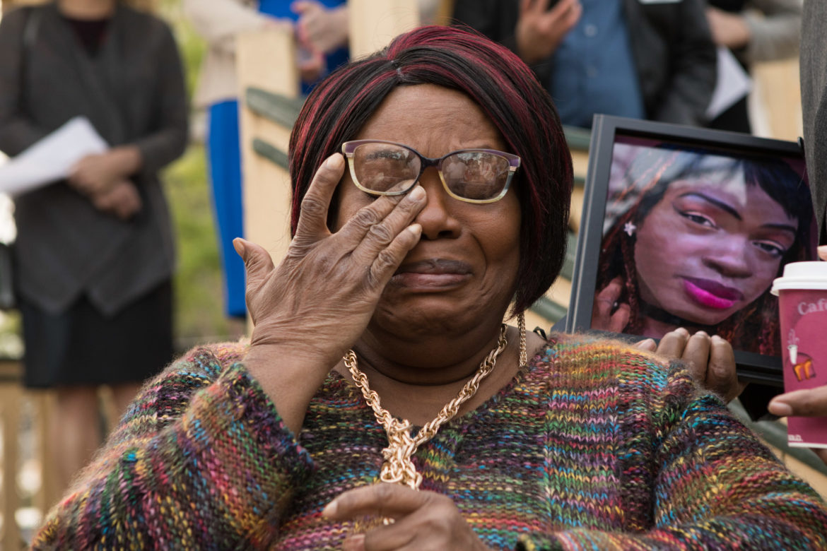 Joann McFadden cries while speaking about the memory of her child Kenne McFadden at a rally at Crockett Park to protest a ruling made in McFadden's case.