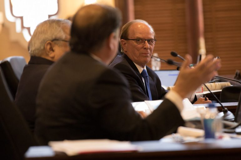 Bexar County Judge Nelson Wolff motions to County Commissioner Sergio Rodriguez (Pct 1) during discussion.