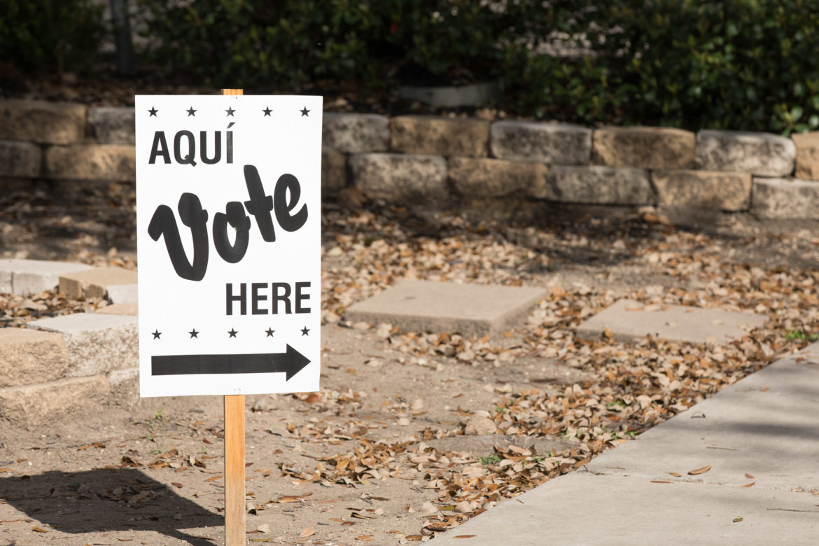 A sign pointing community members to a voting site.