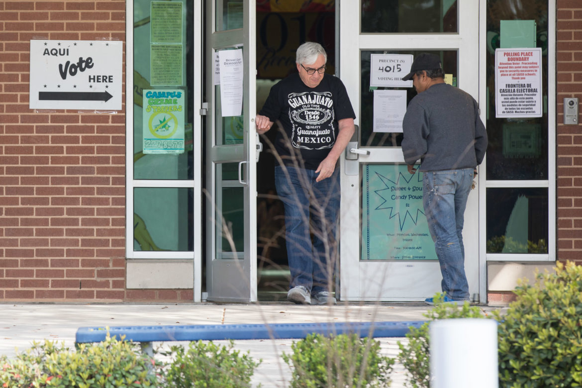 Community members enter and exit Beacon Hill Elementary School on election day.