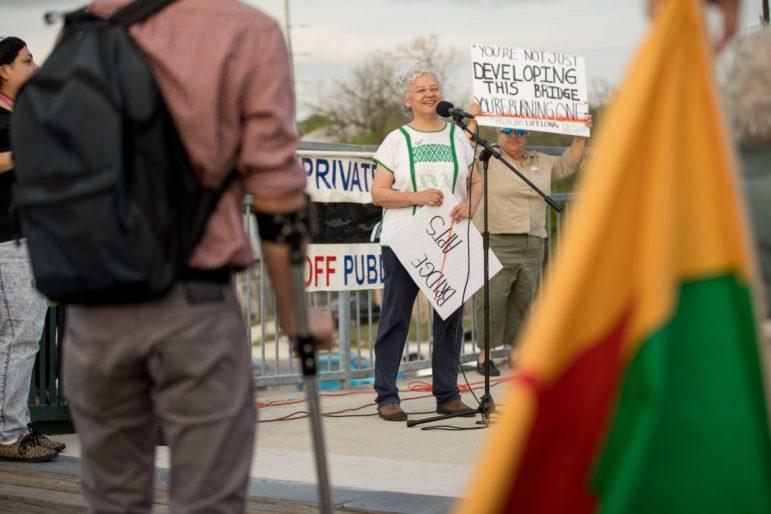 Esperanza Peace and Justice Center Director Graciela Sanchez organizes the vigil.
