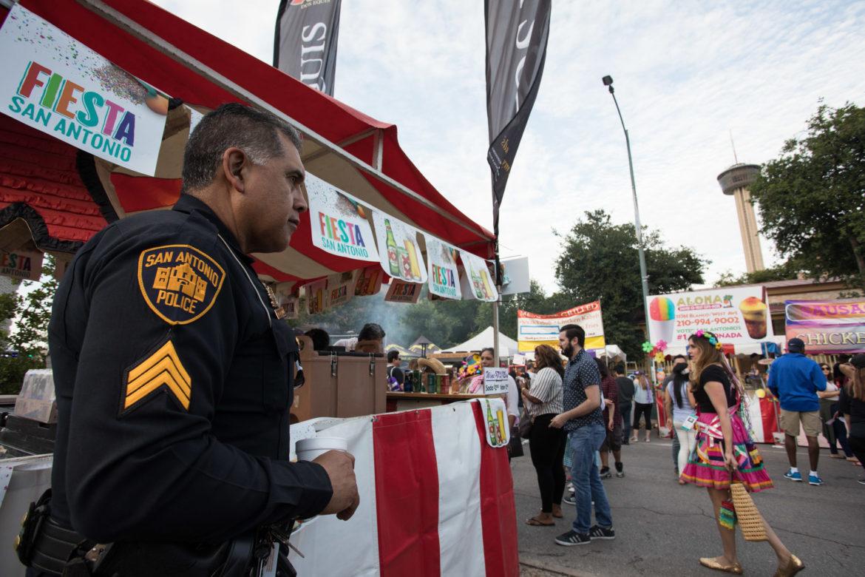 Police officer Joe Correa aids in keeping Fiesta Fiesta secure and safe.