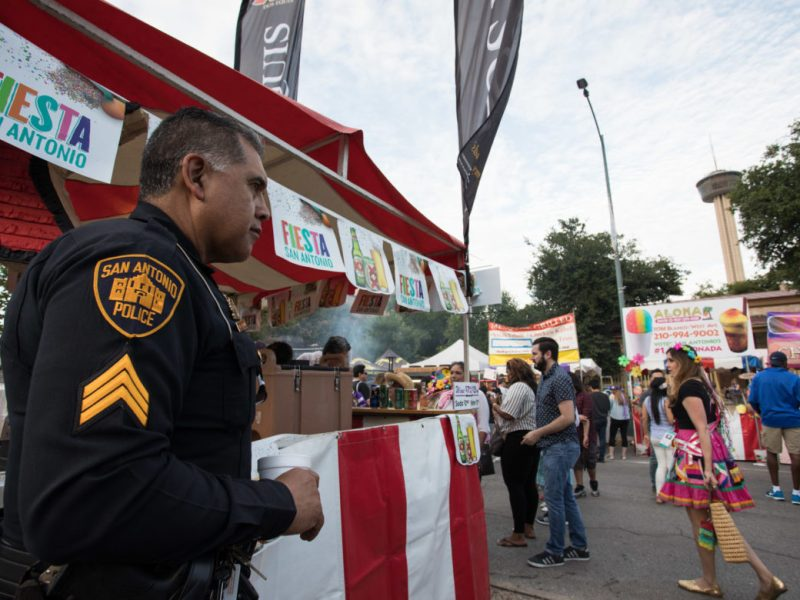 Police officer Joe Correa aids in keeping Fiesta Fiesta secure and safe.