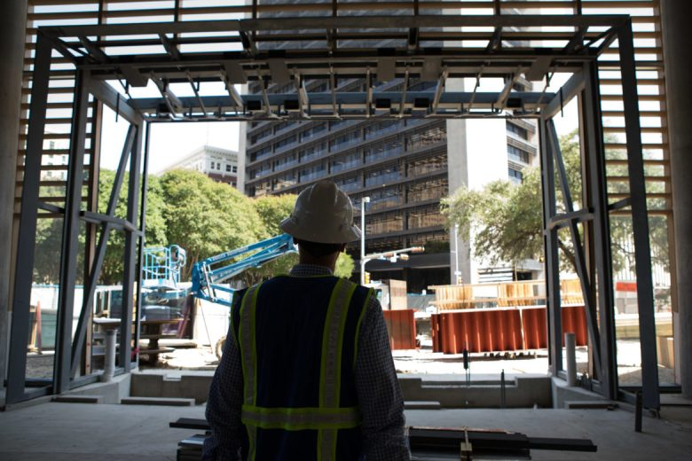 Weston Urban CEO Randy Smith gazes at the future entryway to Frost Tower.