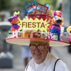A man wears a Fiesta-themed hat.