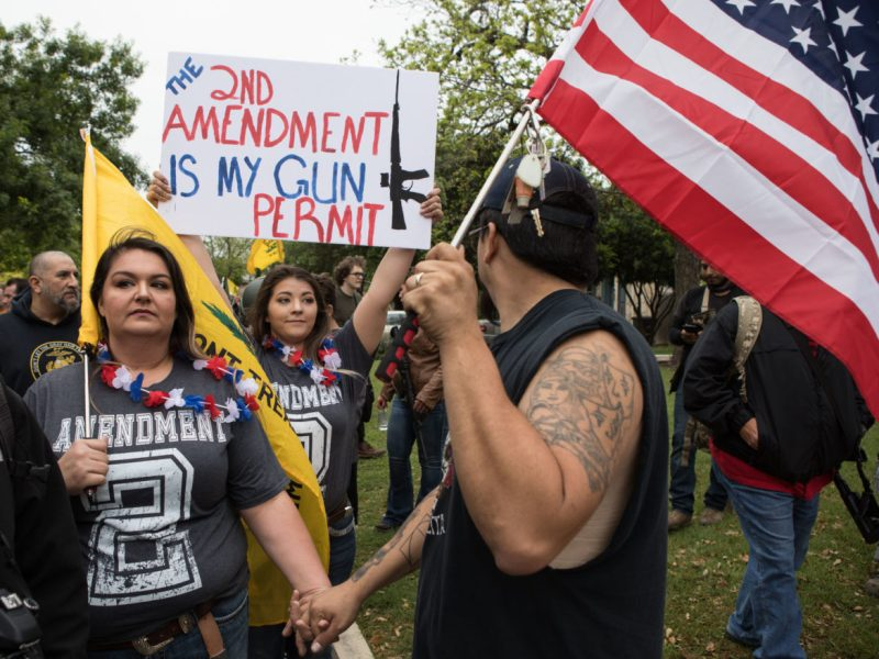 People participate in a Second Amendment rally in Olmos Park in 2018.