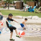 Children play in the splash pad during the ¡Viva Hemisfair! Friday Kick-Off at Yanaguana Garden.