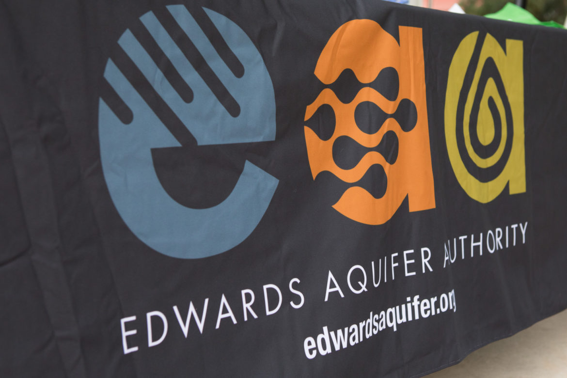 Edwards Aquifer Authority logo on the side of a table.