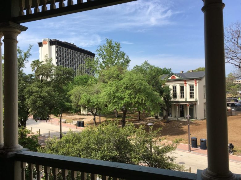 A view from the 2nd floor porch of the historic Herman Longini House on the Hemisfair grounds, which will feature an exhibit on the lost neighborhoods Hemisfair replaced. In the background are the restored historic Schultze House, and the Hilton Paseo del Rio hotel, built by H. B. Zachry as a favor to the City in time for its HemisFair 1968 opening.