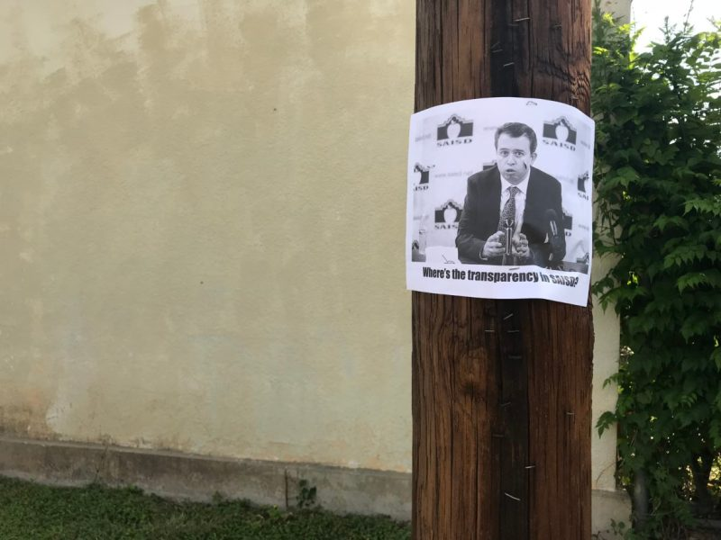 A Rivard Report photograph of Superintendent Pedro Martinez is stapled to a powerline post in the King William Neighborhood.