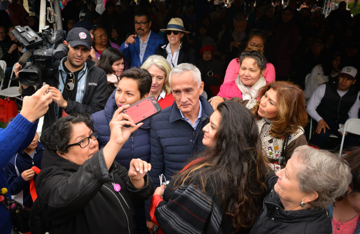 Journalist Jorge Ramos is swarmed by well-wishers as he arrives to speak at the San Antonio Book Festival Saturday at the Central Library.