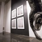Juan Zavala Castro's piece Self-portrait as a Trapped Jaguar is hanging from the gallery ceiling.