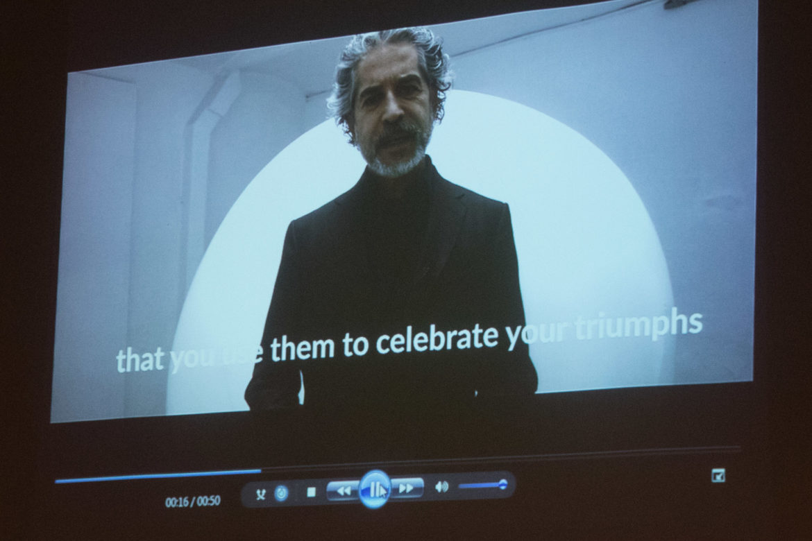A video of Jorge Marín describing his sculpture is played at the unveiling.