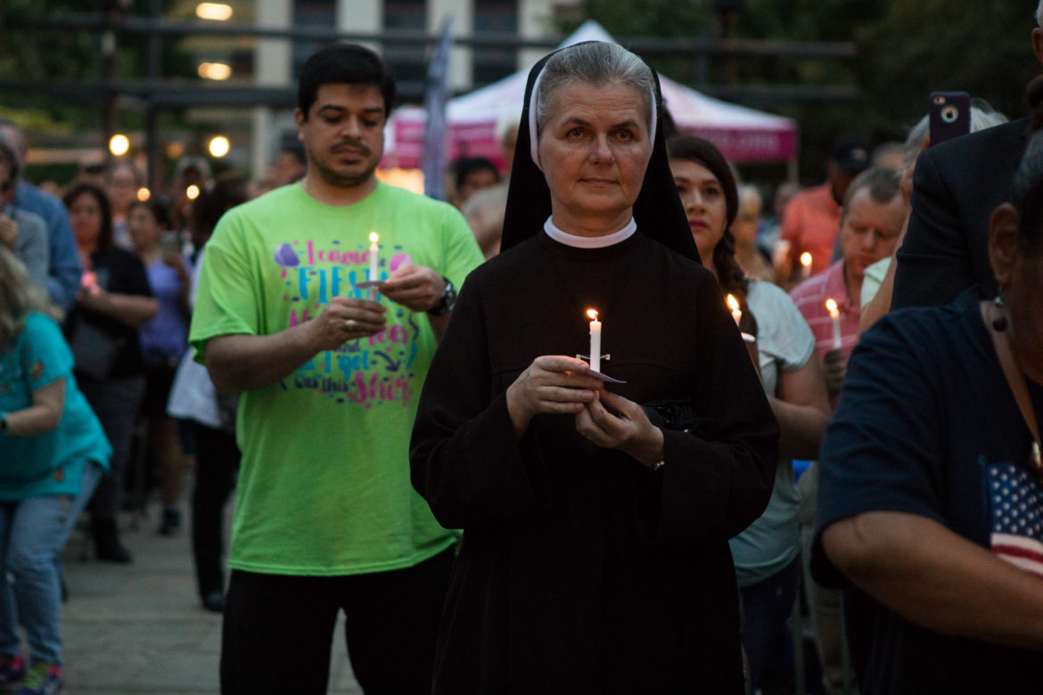 Sister Agnes holds her candle during the candlelight vigil.