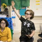 """Stone, a fourth grader at Lamar Elementary School, raises his hand to discuss how he has felt """"assertive."""""""