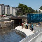 A large mural is visible facing north along San Pedro Creek.