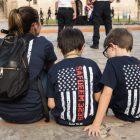 Two boys wear shirts honoring the memory of Scott Deem.