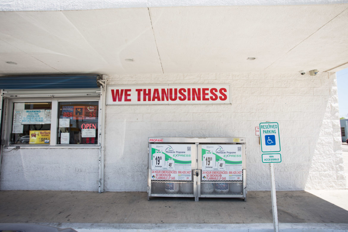 """Molina's San Antonio Country Store, located at 700 N. Alamo St. next to Shell, displays a sign reading """"WE THANUSINESS."""""""