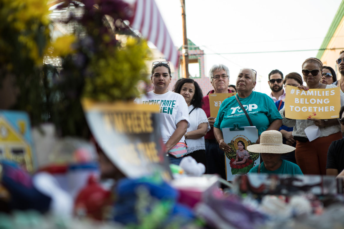"""Supporters of the """"Families Belong Together"""" movement listen to the stories of immigrants."""