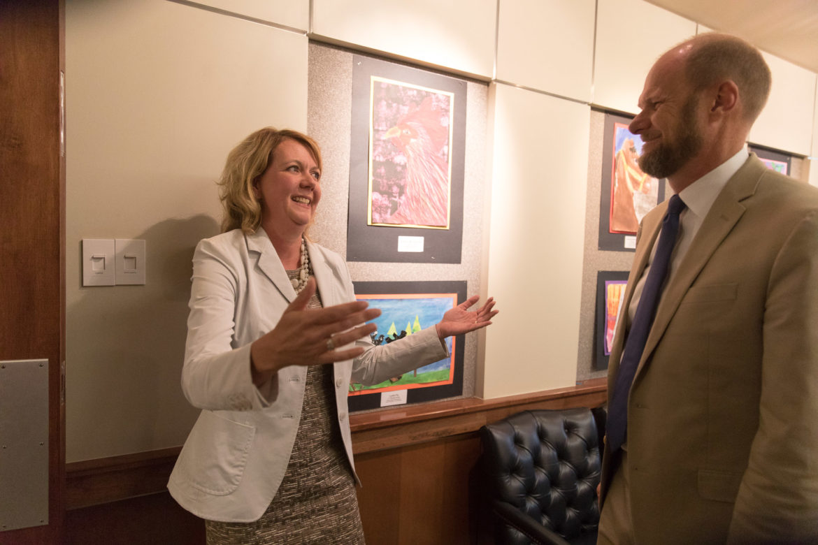 Outgoing Alamo Heights Superintendent Kevin Brown (right) approaches Dana Bashara after the announcement she will be a finalist for the superintendent position.