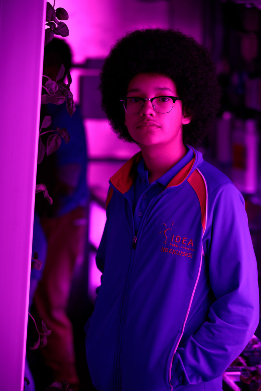 Eighth-grader Cristian Duran explores the hydroponic farm at IDEA Public Schools' Eastside campus.