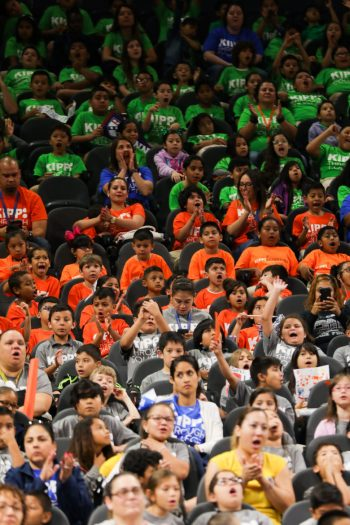 Children from KIPP schools across San Antonio cheer for graduating seniors.