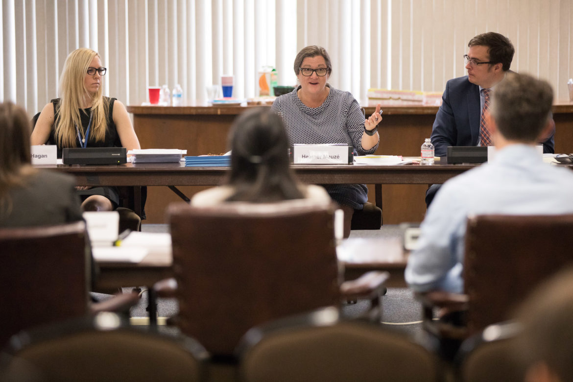 Texas Education Agency (TEA) Director of Charter School Administration Heather Mauzé questions members of the Promesa Academy board.