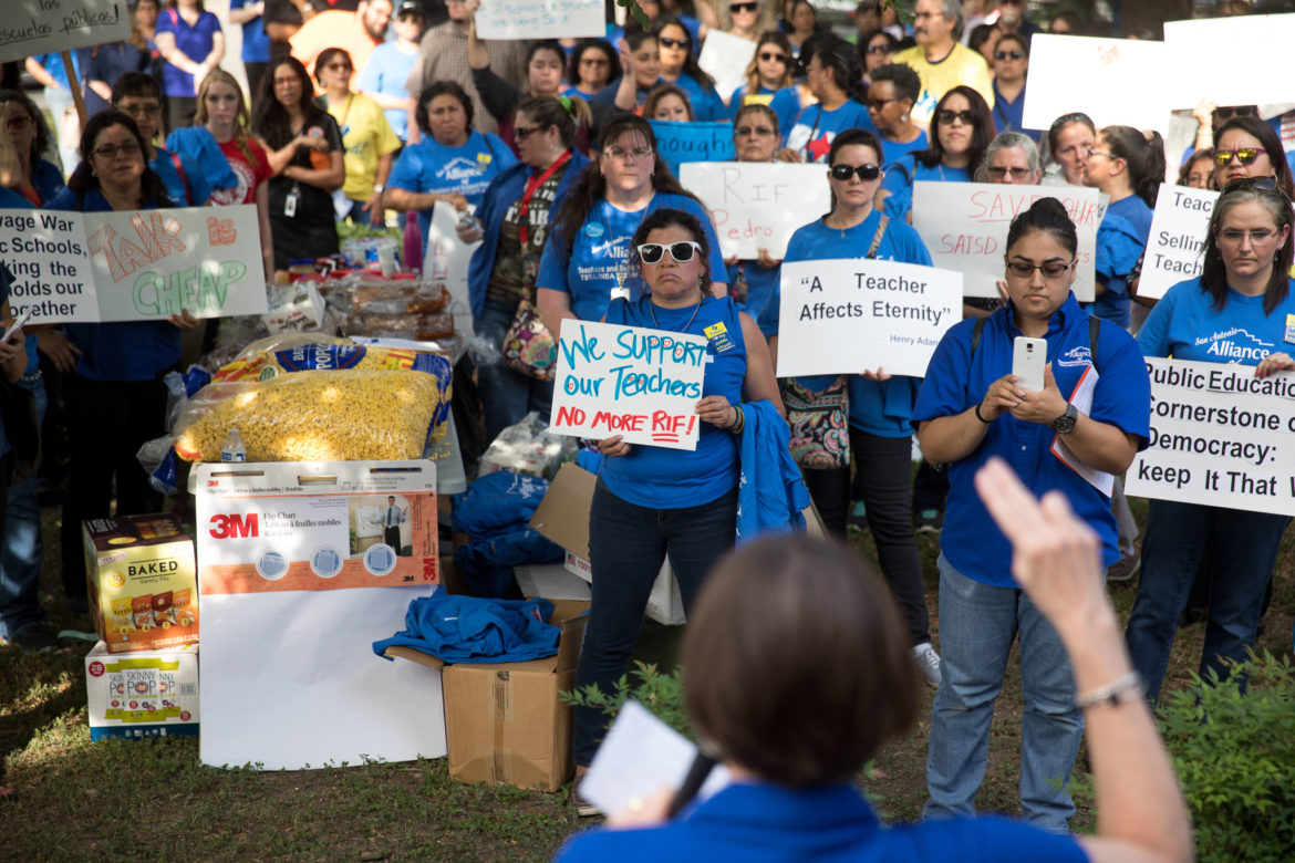 Members of the San Antonio Alliance of Teachers and Support Personnel rally before the SAISD board meeting.