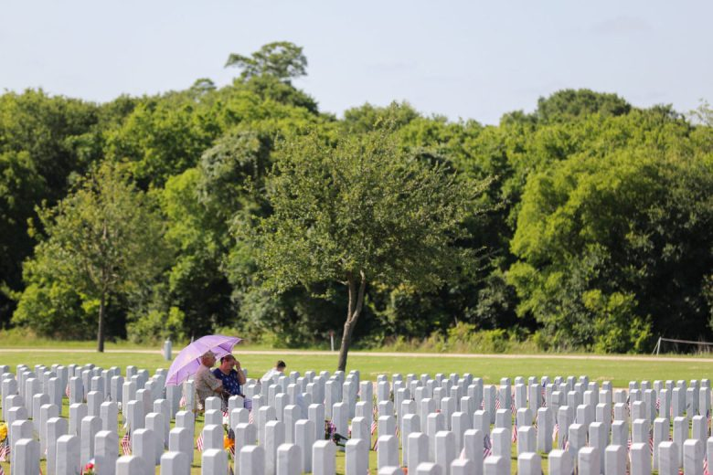 Families visit loved ones on Memorial Day at Fort Sam National Cemetery.