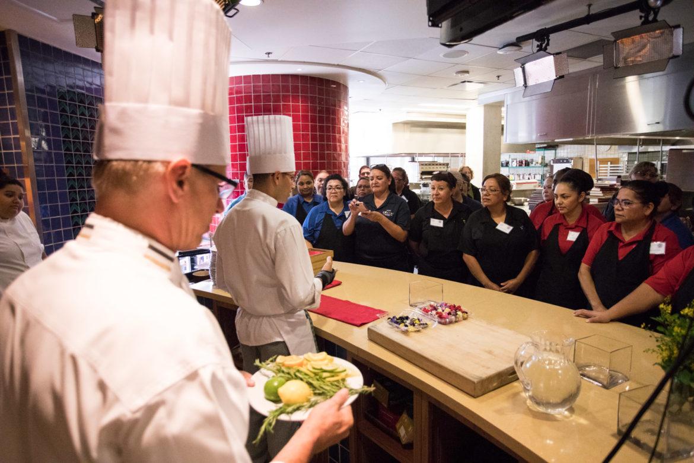 Chef Justin Ward, CIA assistant professor, demonstrates table setup design.