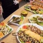 A plethora of food is laid out buffet-style.